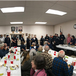 scripture dinner 2018 - wide view of tables of people eating